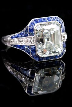 Pictured above is a classic example of Art Deco excellence, executed by an unknown maker in platinum, sapphire and diamonds. The strong, clean geometric lines create an iconic Jazz Age look. Featuring the quintessential 1920's diamond cut, an Asscher weighing in at over 5 carats, this ring proves Deco style is just as beautiful today as it the day it was made.