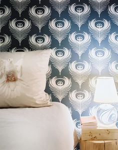 Blue Bedroom - Blue-and-white peacock-feather wallpaper in a bedroom