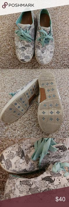 Toms Sneakers(Paseos) Toms sneakers (Paseos) Size 7.White Canvas Sketched sheep pattern. Seafoam inside and laces. Only worn a few times and in great condition. Toms Shoes Sneakers