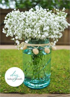 Baby's Breath...don't care for the tasseled ribbon around the neck of the jar, but would be really cute with rope, raffia, or ribbon.