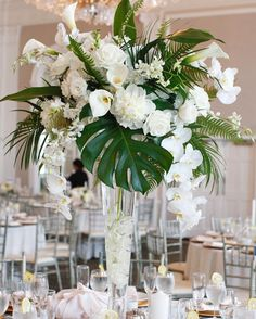 Great Photographs tropical Wedding Centerpieces Suggestions Centrepieces tend to be just to the guests. They stumbled on demonstrate enjoy and appreciation with the coupl. Tropical Wedding Centerpieces, Tropical Wedding Decor, Palm Wedding, Wedding Venue Decorations, Floral Centerpieces, Floral Wedding, Floral Arrangements, Wedding Flowers, Centerpiece Ideas