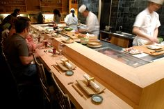 The sushi counter at Jewel Bako Open Kitchen Restaurant, Restaurant Counter, Restaurant Plan, Sushi Bars, Kitchen Counter Design, Kitchen Layout, Sushi Store, Sushi Bar Design, Sushi Counter