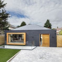 Take the full tour of this contemporary home in the new issue of Homebuilding & Renovating. With an eye for a bargain Darren and Lucy Henderson bought a derelict garage site in Bournemouth and transformed it into a striking family home with a living space basement level . Photo: Simon Maxwell . #homebuilding #selfbuild #design #ideas #architecture #archilovers #kitchen #livingroom #bedroom #bathroom #basement #kitchendesign #pendentlight #modern #contemporary #livingroomdesign #idea #home