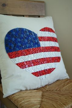 Patriotic heart pillow decorated with buttons.