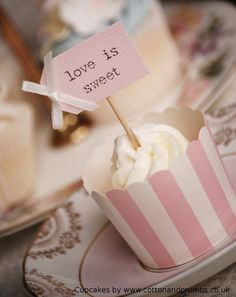 Love is Sweet Party Picks - blush pink and ivory bows. £3.72 for 8, via Etsy.    If you have time on your hands and a crafty inclination, you could make your own with toothpicks and either die cut or handcut cards.  That way you could personalise one for each wedding guest and give individual cupcakes as favours.