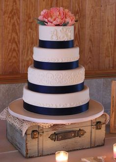 Navy and coral wedding cake with sugar peonies