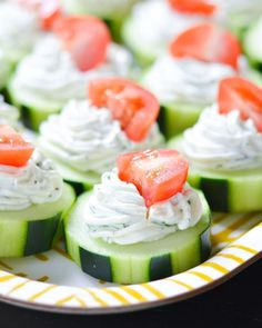 These fresh Dilly Cucumber Bites make a great healthy appetizer. Cucumber slices are topped with a fresh dill cream cheese and yogurt mixture, and finished with a juicy cherry tomato. Parties and g… Appetizers For A Crowd, Finger Food Appetizers, Healthy Appetizers, Appetizer Recipes, Healthy Recipes, Party Appetizers, Ladybug Appetizers, Tomato Appetizers, Cucumber Appetizers