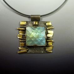 Ana Pendant by Katie Saunders at Oblivion Jewellery. Sterling silver with 24k gold vermeil and checker-cut labradorite.