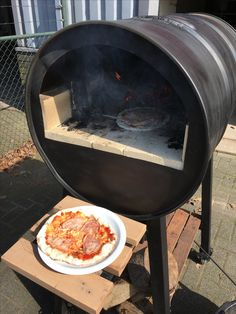 Home made pizza in a oil drum pizza oven!