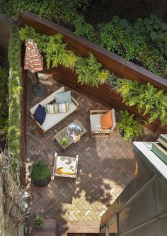 Herringbone-patterned brick brings timeless elegance to a tiny backyard patio in NYC. Ipe fencing brings a modern look and privacy. Small Backyard Gardens, Backyard Patio, Timeless Elegance, Fencing, Rooftop, Herringbone, Design Projects, Landscape Design, Brick