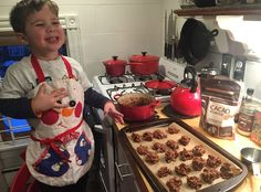 No longer a baby, this giant vegan toddler likes to help in the kitchen. Here, he helps make vegan no-bake cookies from maple syrup, raw cacao powder and rolled oats.