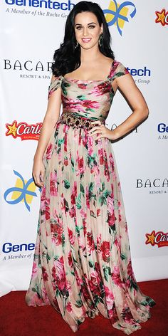 Katy Perry arrived for the Dreams Award Gala in a printed Dolce & Gabbana gown, statement earrings and a Le Vian cocktail ring.