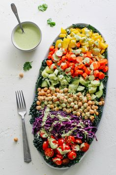 Fresh chopped oil-free vegan salad with raw rainbow vegetables and chickpeas dressed with an oil-free green cilantro tahini sauce! Source by kristenAhong The post Chop& Chickpea Salad with Green Cilantro Tahini appeared first on Die schönsten Salate. Diet Salad Recipes, Vegan Recipes, Tahini Dressing, Salad Dressing, Rainbow Salad, Chickpea Salad, Mindful Eating, Vegetable Salad, Vegetable Recipes