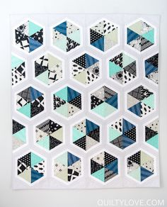 Cotton and Steel Triangle Hexies quilt pattern.  By Emily of quiltylove.com.  Modern triangle quilt using Cotton and Steel's black and white fabric line along with their basics fabric line.