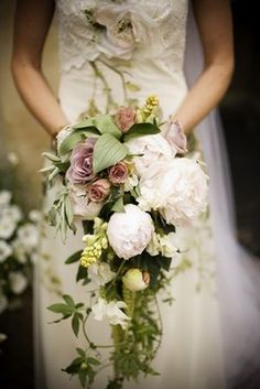 Love this modern, loose cascade bouquet! hand-tied has been popular for soooo long now..nice to see something different
