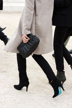 Long chic and simple coat, all black top and pants paired with ankle booties with blue soles #winter #outfit #fall