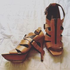 Tan Strappy Vera Wang Heels Used Vera Wang tan Strappy heels. Still in good condition. SUPER comfortable and great with jeans or a sun dress. Decorative buckles and zipper up front of shoe. More photos upon request! Vera Wang Shoes Heels
