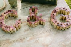 { wisp + whim: Wedding Wednesdays : The Details : Décor & Signage } Rustic, eclectic welcome table with bride & groom's initials spelled out in wine corks // Photography by heidi-o-photo #rustic #wedding #welcometable #SanDiego #LaJolla #MartinJohnsonHouse #winecorks