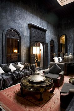 Dramatic and moody atmosphere in this living room with Moroccan and Asian influences.