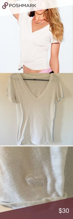 • Victoria secret tee • The one. The only. The Essential V-Neck Tee! Soft enough to sleep in and made to mix and match, this must-have t-shirt is the perfect 24/7 layering piece. Brand is Victoria's Secret PINK. Size is Large. Fabric is 60% cotton and 40% polyester. Worn 1 time. Victoria's Secret Tops Tees - Long Sleeve