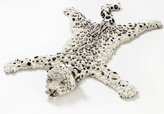 Pompon Snow Leopard consists of over 700 handmade pompoms made from a merino wool and merino wool mixture - with the exception of the nose and muzzle which are wool felted by hand.