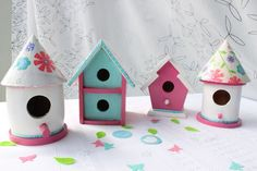 Use these bird houses as decorations in the room.  Maybe suspend from the ceiling?