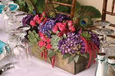 mix up the centerpieces with flowers, succulents, and feathers or other decorative pieces (like pearls)