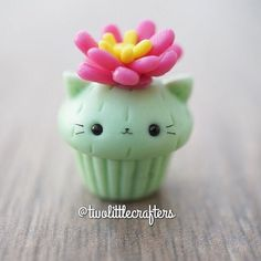 Custom cactus kitty cupcake with a succulent plant on top! This one was inspired by @theclaycroissant Meghan's adorable cactus bear and bunnies. . Enjoy your day! . . . #polymerclay #handmade #cat #claycreations #cactus #succulove #succulents #cactuscat #kawaii #cutecrafts #cupcakecharm #sculpey #fimo