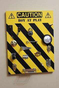 Caution Boys At Play Toddler Busy Board Construction Style...what a neat idea!!!  @Style Space & Stuff Blog @AbdulAziz Bukhamseen Home Sweet Home Blog @عبدالعزيز الجسار Bukhamseen Home Sweet Home Blog for Luca @Caylene Hinger Hinger Hinger for Parker. Shoot I'd even do this for Gretchen girlie style if it kept her busy! :)