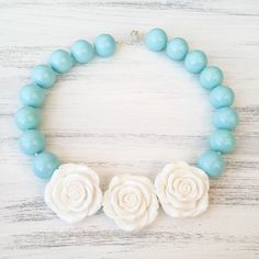 Blue and white triple rose necklace, blue and white bubblegum necklace, necklace with flowers, kids flower necklace, baby necklace, baby fashion, kids fashion, toddler fashion, kids beaded necklace, 1st birthday outfit, 1st birthday gift, baby photo prop, blue baby photo prop, flower girl necklace, gifts for girls, baby gifts, kids gifts, kids ootd, baby ootd, baby boutique, kids boutique, etsy jewelry.  https://www.etsy.com/listing/386354546/bubblegum-blue-and-white-triple-rose