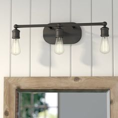 Effortlessly elevate any ensemble in your home, and bring a warm glow to the space, with this chic vanity light. Blending casual farmhouse style with modern elegance, this lovely luminary will make a statement in your space. The sleek neutral-toned metal frame lets this piece blend in with any setting, while the three exposed Edison-style bulbs give it a touch of contemporary industrial appeal. Try adding this vanity light to above your master suite bathroom sink to light up your morning…