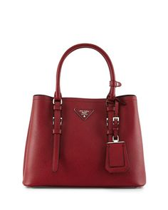 """Prada saffiano leather tote bag. Top handles with buckled straps and keeper; 5.3"""" drop. Removable shoulder strap; 23.3""""D drop. Detachable ID tag. Triangle logo with metal lettering. Compartmentalized"""