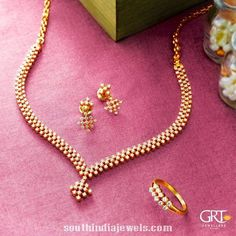 Simple diamond necklace set from GRT Jewellers. The necklace set consists of pair of earrings and rings. For inquiries please contact +914423461551.