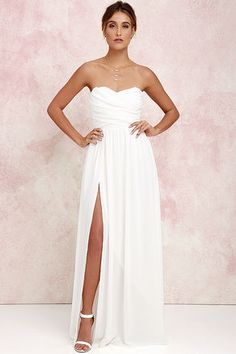 You'll be admired as soon as you set foot in the party wearing the Moonlight Serenade Ivory Strapless Maxi Dress! Draping woven poly fabric adorns a strapless sweetheart neckline with lightly padded cups and no-slip strip. A gathered waist introduces a full, maxi skirt with sexy side slit. Hidden back zipper and clasp.