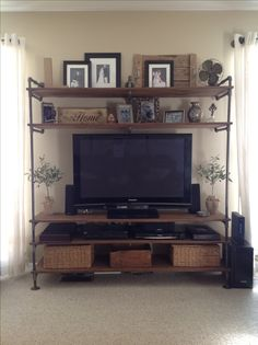 Entertainment center made out of cast iron pipes.