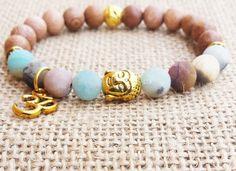 Check out this item in my Etsy shop https://www.etsy.com/uk/listing/248201196/rose-wood-amazonite-bracelet-buddha