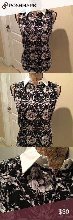 ADORABLE black and white sleeveless floral blouse! So feminine and stylish!!!  This black and white floral is offset by the bright white collar. Wear this with shorts in summer or pair it with a blazer or suit for business.  Either way, it's a hit!!! 🌺🌺🌺 Premise Tops Blouses
