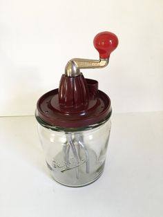 This item is an Original Rührfix bakelite hand mixer/reamer. Origin is Germany around the 1930's to 1940's.  Glass mixing container with measure marks of 1/4 L, 1/2 L, 3/4 L so probably holds 1 Liter. Mixing container has no chips or cracks, no marks on bottom and has Rührfix in script embossed on side. As seen in picture #2 this mixer has metal gears, not plastic. This works great and will continue to be useful for a very long time.    As shown in provided pictures the handle can be removed…