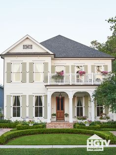 Foyers, Porches + Front Doors This New Orleans home has majorly dreamy curb appeal. It's sage green Exterior House Colors, Exterior Design, Exterior Paint, Farmhouse Shutters, Green Shutters, Green Front Doors, Porch Addition, New Orleans Homes, Decks And Porches