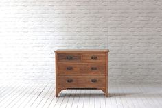 An Edwardian walnut chest of drawers (1901-1910)  Two short over two long drawers with decorative metal handles sanded to original wood and waxed.