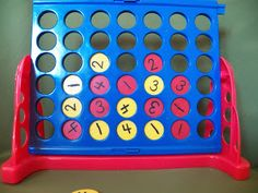 "Change a connect four game into a ""make Ten"" game great for practicing addition! You could even do this to make a dollar using different coins."