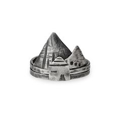 The stacking rings may be worn as individual accents, or together to form a miniature tribute to a peaceful mountain village.