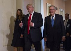 President-elect Donald Trump, flanked by his wife, Melania, and Senate Majority Leader Mitch McConnell of Ky., gives a thumbs-up on Capitol Hill in Washington, Thursday, Nov. 10, 2016, after their meeting.  The election of Donald Trump as president is a bitter pill to swallow for millions of Americans
