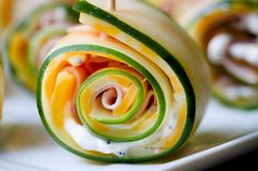 These Cucumber Ham Rollups are light, healthy are super low in carbs!  They are perfect for lunch, snacks or backyard cookouts!  Get your YUM on today!