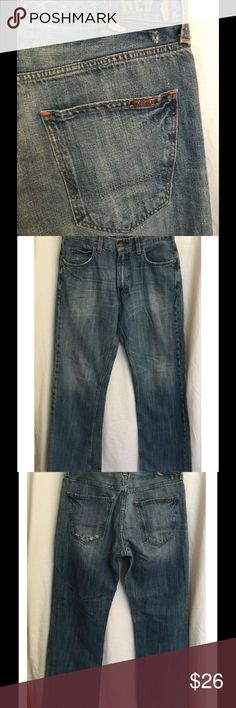 Hollister jeans Boot cut style. Spots of distressing & wear--small hole on back below waistband--was made this way. 100% cotton. Excellent condition. Size 32 X 34 Hollister Jeans Bootcut