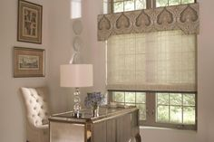 Upholstered Cornice Board with Woven Wood Romans. What a clean but festive look. www.budgetblinds.com
