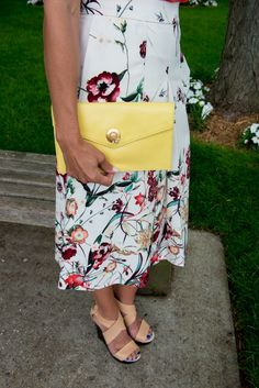 Ladylike summer clutch from @talbots the bee clasp is such a cute feature. Pretty yellow handbag that can be dressed up or down. Click photo to see the full outfit.