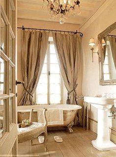 Master bath - like chandelier, curtains & sink.