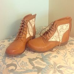 NEW cognac, faux leather booties, Cherokee, size 6 Like brand new! Lace up cognac colored booties with ivory lace embellishment, size 6 (fits like a 7). Made by Cherokee and perfect transitional bootie for jeans, skirts, and dresses. No wear on soles. Cherokee Shoes Ankle Boots & Booties
