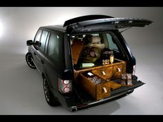 Range rover outfitted with a scotch and champagne bar, plus custom gun cabinets. Beyond decadent and wonderful.